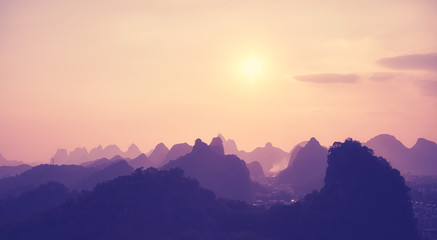 Color toned scenic sunset over Karst mountains in Guilin, China.