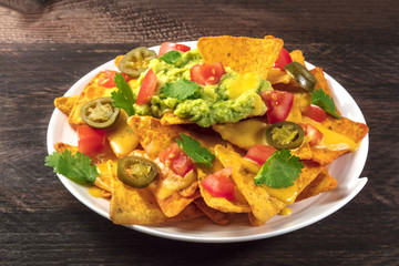 Nachos with cheese and hot peppers, traditional Mexican snack