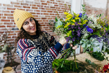 Cheerful woman with pretty bouquet
