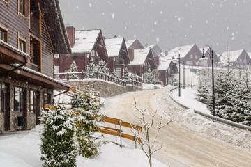 Beautiful scene of winter ski resort residence during snowfall