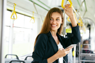Woman Listening Music On Phone Riding In Bus.