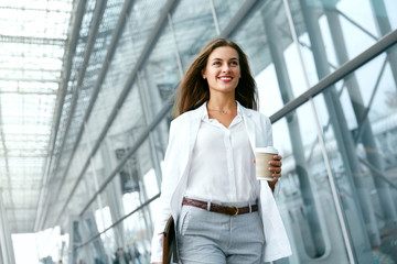 Beautiful Woman Going To Work With Coffee