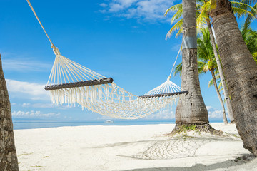 Hammock between palms on the beautiful tropical beach.