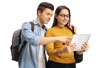 Teenage students looking at a tablet