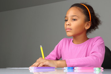 the girl dreams about drawing on paper.