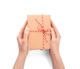 Woman holding parcel gift box on white background, top view