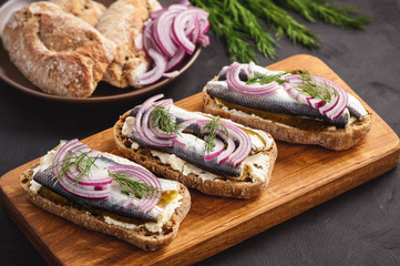 Herring sandwiches with pickled cucumber.