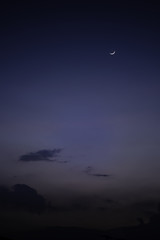 Night sky and crescent moon.