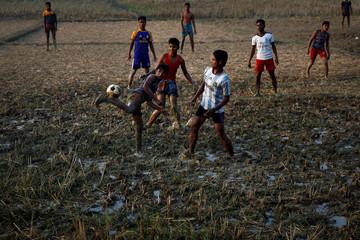 Rohingya refugees play soccer at the Balukhali refugee camp near Cox's Bazar