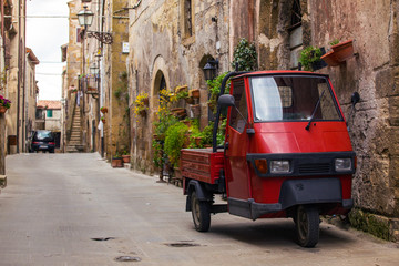 Scooter Piaggio Ape at the empty street