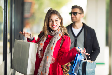 Happy young woman in shopping