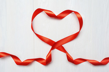 Mockup Heart a red tape on white wooden background. Card love Valentine's Day. Flat lay, top view with a place for your text