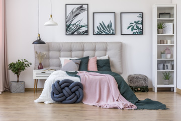 Modern bedroom with knot pillow