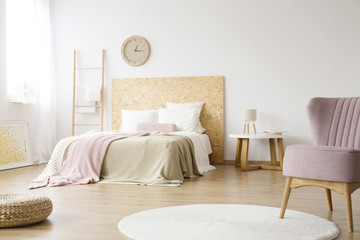 White carpet in bright bedroom