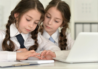 twins girls using digital devices