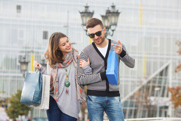 Couple on a shooping date having a good time