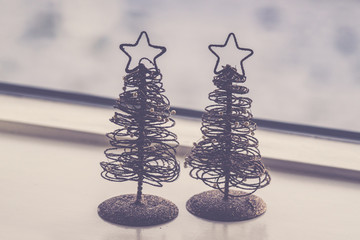 Two small decorative Christmas trees