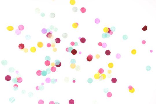 Multicolored confetti on white