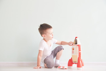 Active little boy playing the rocket toys, Child showing rocket toy with happy face, Children or Toddler learning and Development concept