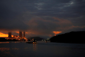 The Dayton Power & Light J.M. Stuart Station lights up the early morning sky on the banks of the Ohio River in Aberdeen