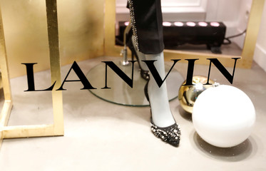The logo of Lanvin, luxury clothing and accessories, is seen on a window of a store of French fashion house Lanvin in Paris