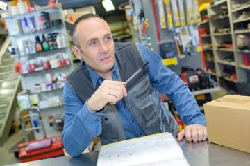 portrait of hardware store worker