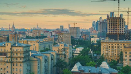 Fototapete - Zoom in on city skyline at sunrise. Moscow, Russia. 4K UHD Timelapse.