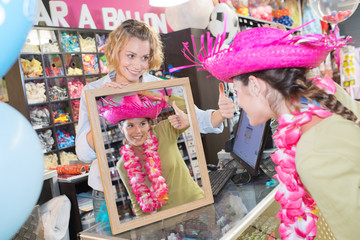 female buying dressing up accessoires