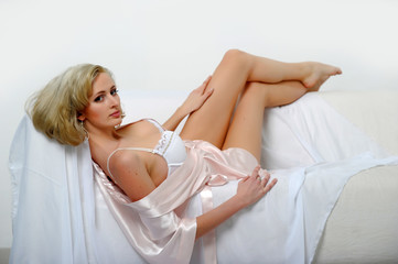 Beautiful young blonde in sexy white lingerie
