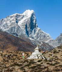 Buddhist stupa on the trail near the Dingboche village. Tabuche peak (6367 m) on background - Everest region, Nepal, Himalayas