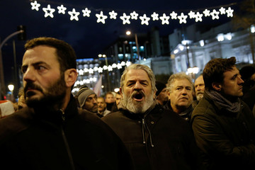 A member from the communist-affiliated trade union PAME shouts slogans during a protest against a planned law under which anyone, who blocks foreclosure auctions of property could face criminal charges in Athens