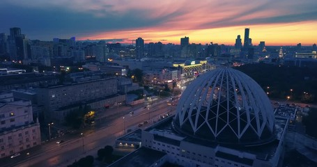 Fotobehang - Aerial view urban architecture skyline night traffic sunset sky background