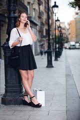 Portrait of smiling girl teenager talking on phone