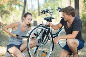 woman pumping her bike up
