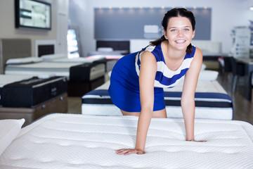 woman testing mattress