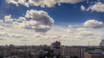 Fototapete - Fluffy white clouds blue sky background urban cityscape Moscow Russia timelapse