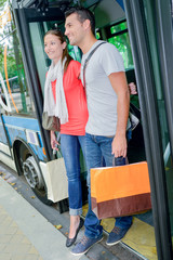 Couple getting off a bus