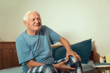 Senior man with osteoarthritis pain in the knee