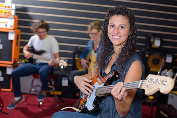 Woman playing electric guitar