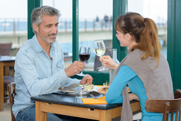 Man and lady toasting with wine glasses