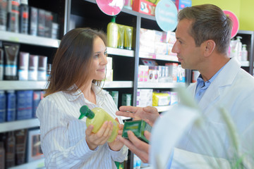 Pharmacist advising customer