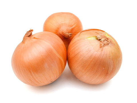 Three onion bulbs isolated on white background