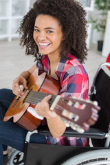 young female musican on wheelchair