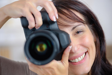 woman taking picture using dlsr