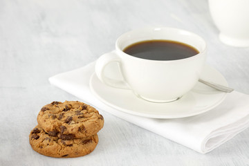 Cup of coffee and cookies on the table.