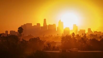 Fotobehang - Sunrise over city, zoom in on modern downtown Los Angeles skyline buildings. 4K
