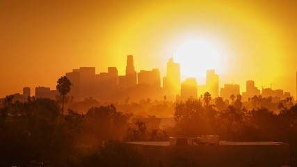 Fotobehang - Sunrise over city, zoom out from modern downtown Los Angeles skyline buildings