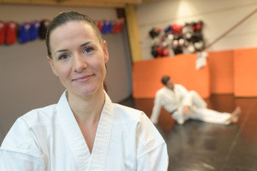confident female in a gym in martial arts training