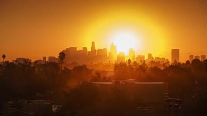Fotobehang - Sunrise over city, closeup on modern downtown Los Angeles skyline buildings 4K
