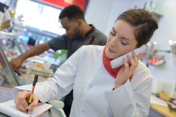 Female chef taking telephone order